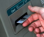 FAYETTEVILLE, NC - AUGUST 03: A man puts a card into an ATM August 3, 2010 in Fayetteville, North Carolina.  A US government report issued August 3 gave evidence that the economic recovery is being stalled by sluggish consumer spending and weak personal incomes.  (Photo by Chris Hondros/Getty Images)